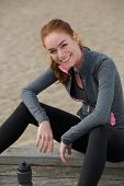 Smiling Sports Woman Sitting Outdoors