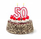 Birthday cake with burning candle number 50