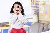 Joyful Little Girl In Class