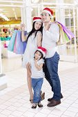 Portrait Of Happy Family At Mall