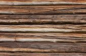 picture of log fence  - Wooden logs wall of old rural house background - JPG