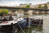 Old Pleasure Boats Are Moored On The Seine River, Paris