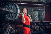stock photo of lifting weight  - Powerlifter with strong arms lifting weights - JPG