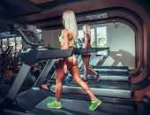 stock photo of treadmill  - young people running on treadmill in gym  - JPG