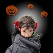 Little Boy Dressed Up As Dracula For The Halloween Party