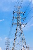 foto of transmission lines  - High voltage power pole and electricity line with blue sky background for power transmission - JPG