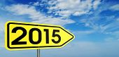 New year 2015 on the yellow arrow sign and sky in the background