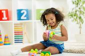 pic of kindergarten  - Kid girl playing toys at home or kindergarten - JPG