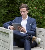 Young Businessman With Tablet