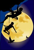 Climbers On The Background Of The Full Moon