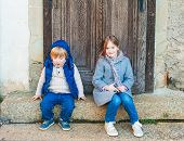 Outdoor portrait of a little girl and her brother