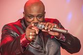 stock photo of singer  - African male singer giving a live soul singing performance - JPG