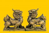 Chinese talisman figurine yellow background