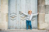 Outdoor portrait of a cute toddler boy