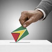 Black Male Holding Flag. Voting Concept - Guyana