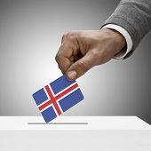 Black Male Holding Flag. Voting Concept - Iceland