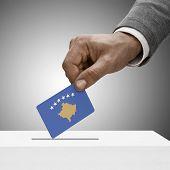Black Male Holding Flag. Voting Concept - Kosovo