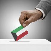 Black Male Holding Flag. Voting Concept - Kuwait