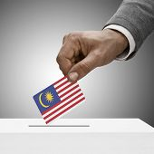 Black Male Holding Flag. Voting Concept - Malaysia