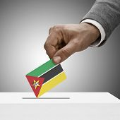 Black Male Holding Flag. Voting Concept - Mozambique