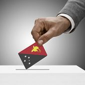 Black Male Holding Flag. Voting Concept - Papua New Guinea