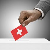 Black Male Holding Flag. Voting Concept - Switzerland