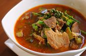 foto of vegetable soup  - hot and spicy soup with pork and local vegetable in Thai country style - JPG
