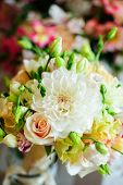 Wedding bouquet with light-colored summer flowers