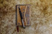 Aged Ornamented Diary With Pen