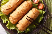 Spring Rolls Fried On Lettuce With Tomatoes Horizontal Top View