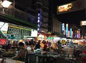 Pedestrians Shop At Liuhe Night Market In Kaohsiung, Taiwan.