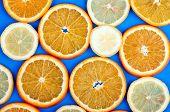 Orange And Lemon Slice On A Blue Background