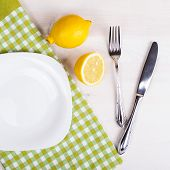 Cutlery On A Napkin On Wooden Background