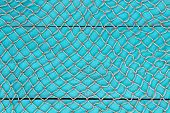Blank antique teal blue aged wooden sign with fish net texture overlay
