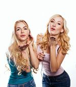 foto of flutter  - Beautiful girls sisters headphones listening to music with fluttering hair - JPG