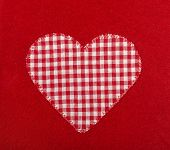 Heart Shape On Red Wool Background.