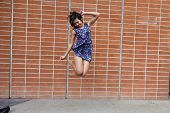 Skinny Asian American Woman Jumping In Dress