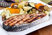 salmon fish steak meal with vegetables