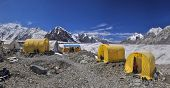 foto of shan  - Scenic panorama of tents on Engilchek glacier in picturesque Tian Shan mountain range in Kyrgyzstan - JPG