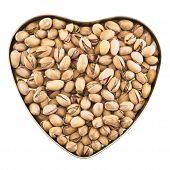 Heart shaped box full of pistachio