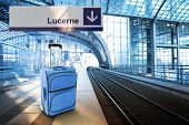 Departure For Lucerne, Switzerland. Blue Suitcase At The Railway Station