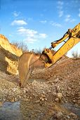 image of excavator  - Excavator spoon on excavation site preparing to digg - JPG