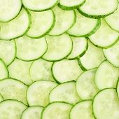 Surface coated with a cucumber slices
