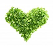 Heart shape made of green onion pieces