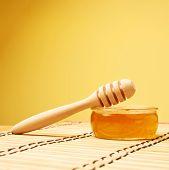 Dipper over a honey jar