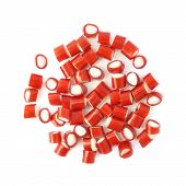 stock photo of foreshortening  - Pile of small red and white candy sweets isolated over the white background - JPG