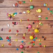 Candies lying over the wooden surface