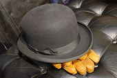 foto of bowler hat  - The black leather seat of a vintage motor - JPG