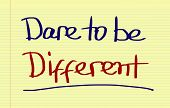 "pic of daring  - ""Dare to be different"" Concept Handwritten With Marker On A Notebook. - JPG"