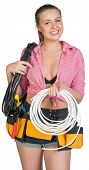 picture of coil  - Woman with coil of power cable on her shoulder - JPG